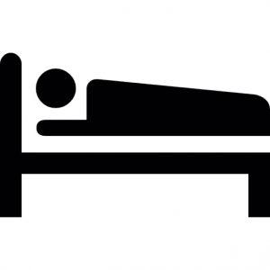 person-schlaft-auf-einem-bett_318-27520
